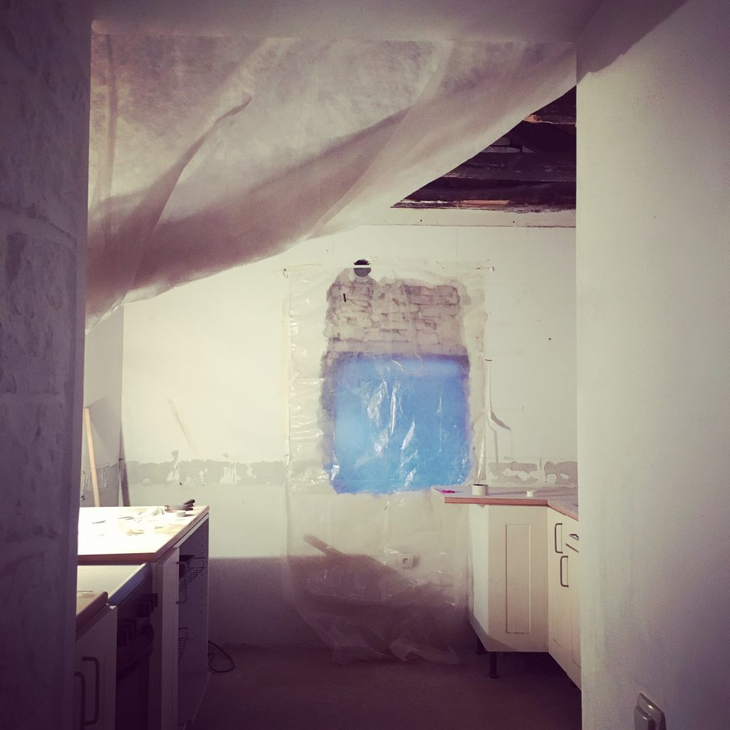 80cm thick walls were punched through to create new window space...