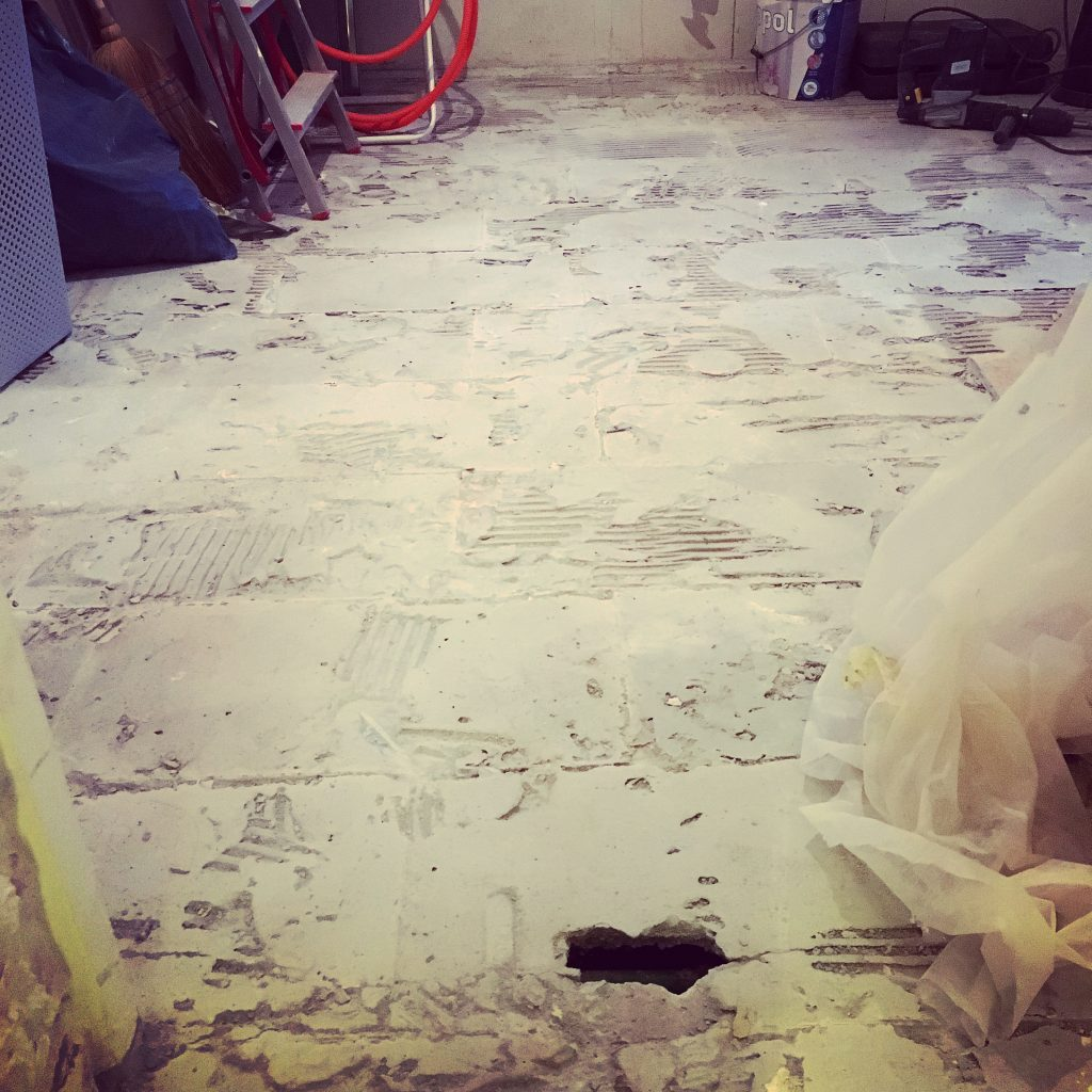 Floor tiles coming up