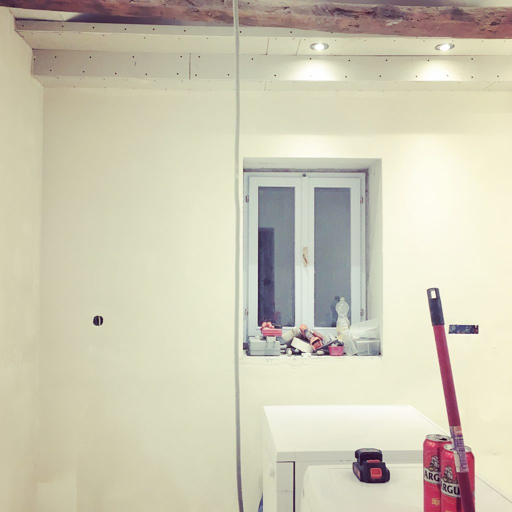 Spotlights in and walls plastered