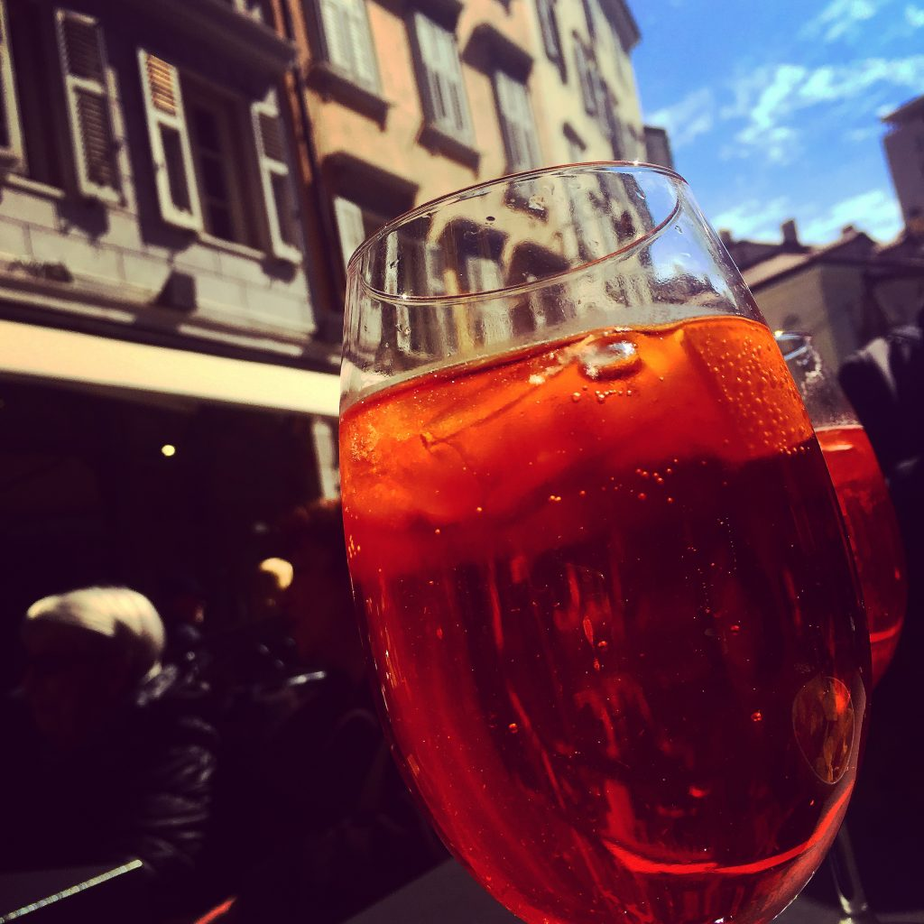 Aperol Spritz in the sunshine. It is the law in Italy.