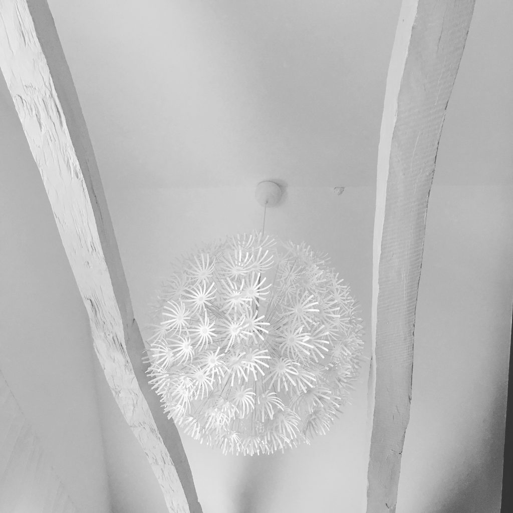 IKEA Maskros pendant lightshades work a treat in the high ceiling - and cast very pretty shadows