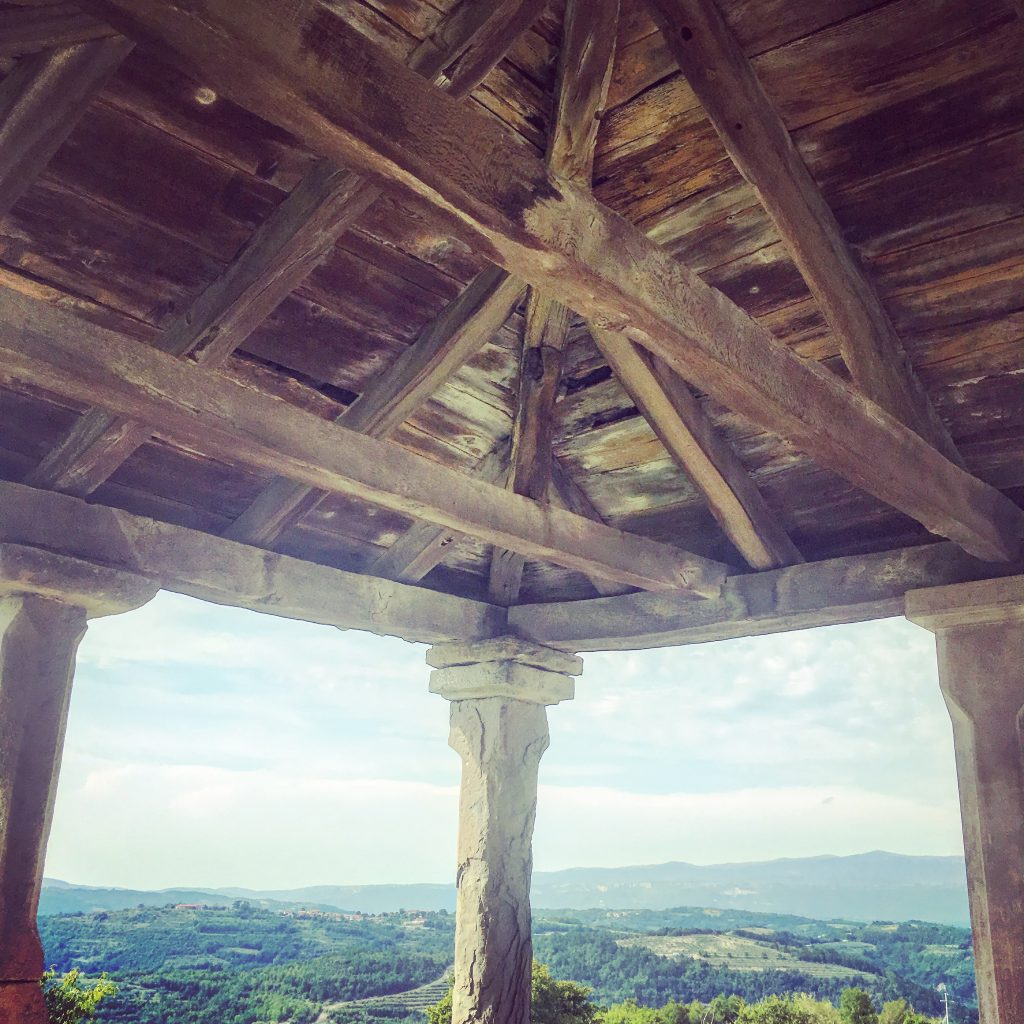 The entrance to the Church of St Roc, with views across the Istrian hills and valleys.