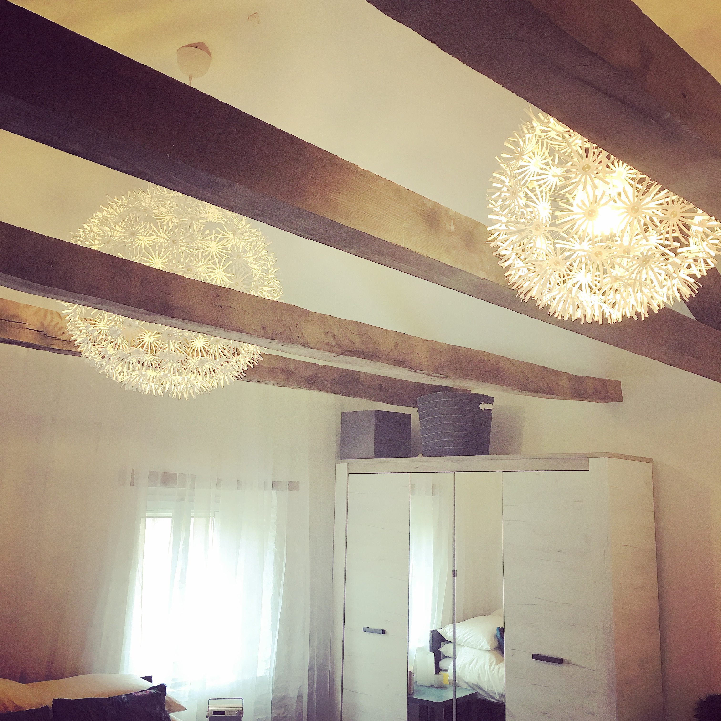 After living with bare lightbulbs for nearly a year, these IKEA shades are a joy...