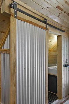 Corrugated iron is an option we hadn't considered, but love the look of this...
