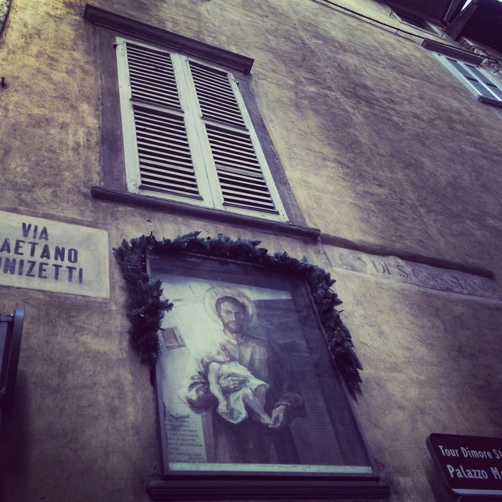 Religious iconography - make sure you look up as these pieces of artwork are all over Citta Alta, Bergamo