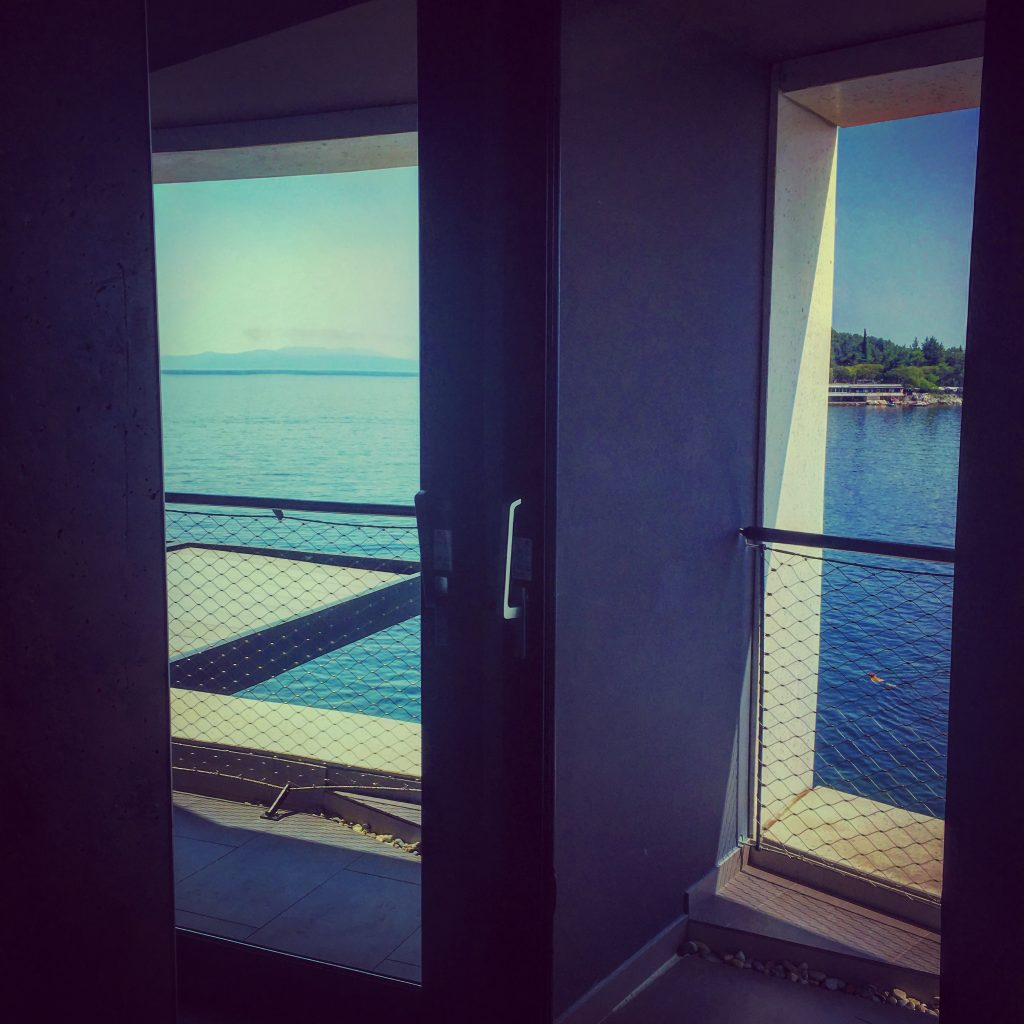 A wall of glass, overlooking Preluk Bay and the islands of Krk and Cres