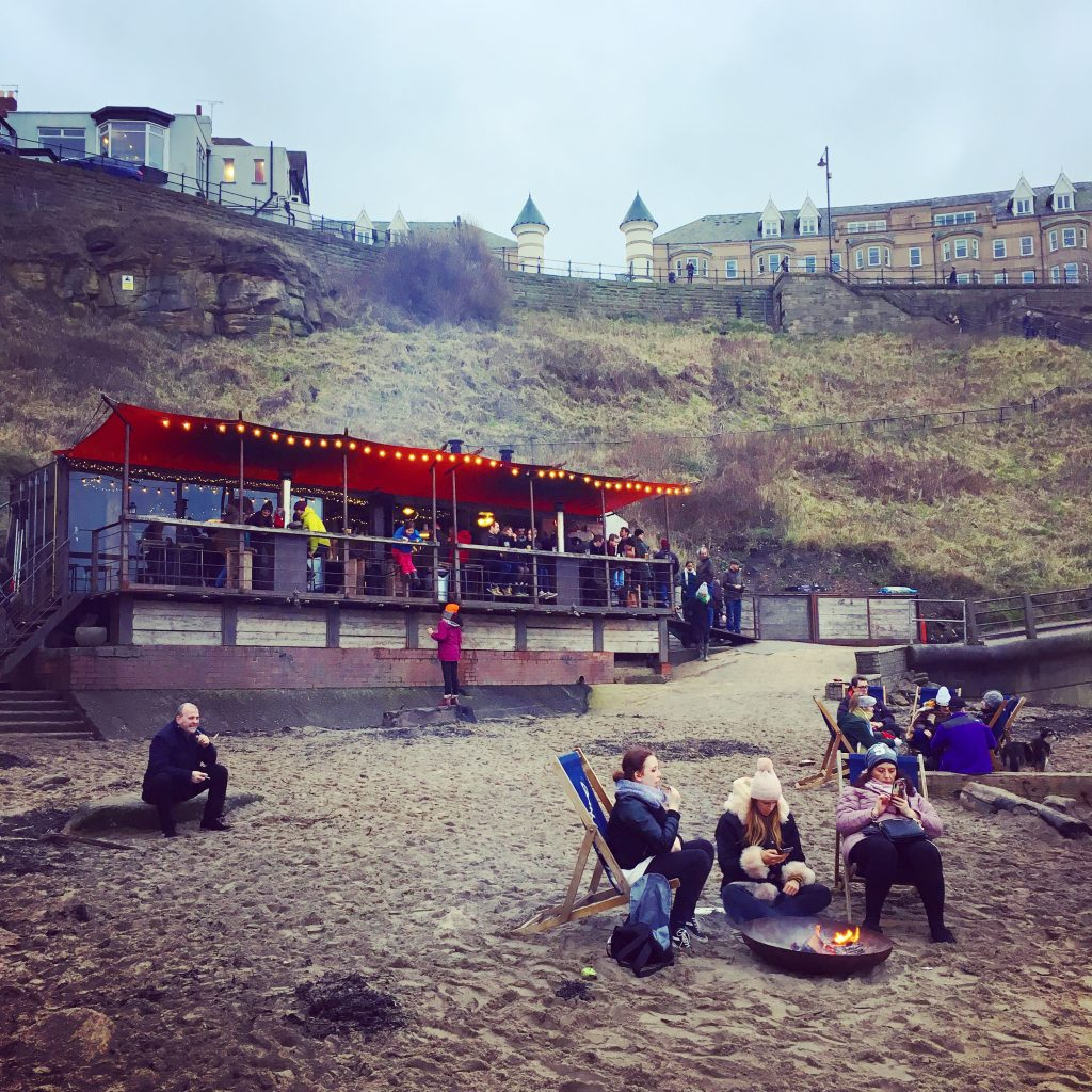 Deck chairs and fire pits, King Edward's Bay, Tynemouth