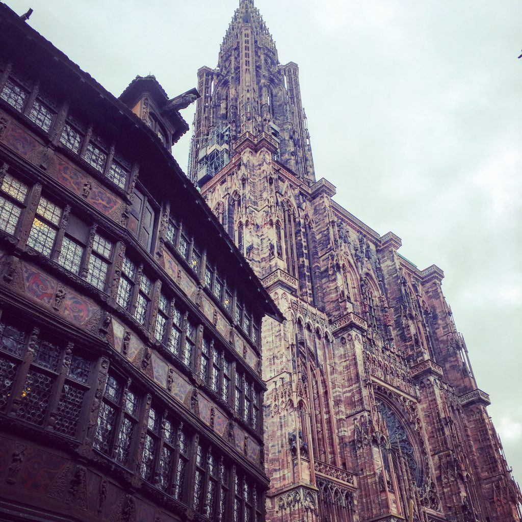 The Cathedral toweing over the oldest building in Strasbourg, La Maison Kammerzell, constructed in 1427